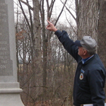 Richard Goedkoop pointing at the 28th Massachusetts Infantry Regiment monument